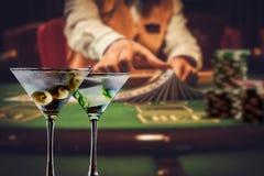 Martini blackjack dealer. Blackjack dealer behind martini glasses in a casino stock photos