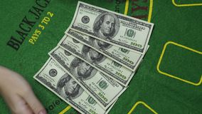 Blackjack Dealer Hands Count Money US Dollar Cash In Casino Background Close Up. Blackjack dealer female hands count money. Hundreds US Dollar bills or notes in stock video footage