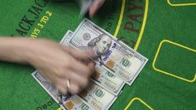 Blackjack Dealer Hands Count Money US Dollar Cash In Casino Background Close Up. Blackjack dealer female hands count money. Hundreds US Dollar bills or notes in stock video