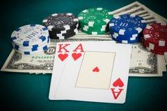 Blackjack, dollar bills and casino chips Stock Photos