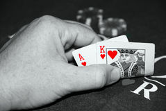 Blackjack hand of cards. And casino chips white&black image with red cards Royalty Free Stock Photography