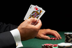 Blackjack hand of cards and casino chips. Blackjack player winning hand of cards and casino chips royalty free stock photo