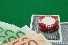 Blackjack hand with Euro notes and chips on green Royalty Free Stock Photo