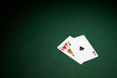 Blackjack hand on green baize. Table ace and king stock image
