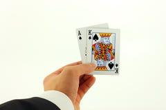 BlackJack-Karten-Hand getrennt auf Weiß Lizenzfreie Stockfotografie