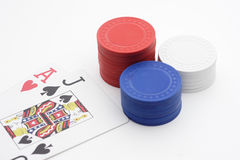 BlackJack with pile of poker chips. On white background Royalty Free Stock Photography