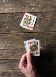 Blackjack. A player holds blackjack in his hand which beats the twenty point hand on the weathered table stock photo