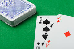 Blackjack.Playing cards on a green background Royalty Free Stock Photo