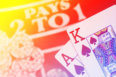 Blackjack playing cards hand on colorful background with chips s Stock Images