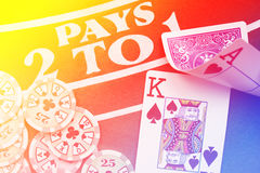 Blackjack playing cards hand on colorful background with chips Royalty Free Stock Images