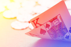 Blackjack playing cards hand on colorful background with chips Stock Photo