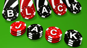 Blackjack Sign On Chips. Blackjack sign on black and red colored chips Stock Photography