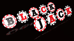 Blackjack Sign Chips. Blackjack sign on black and red colored chips Royalty Free Stock Photography