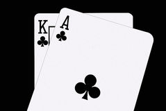 Blackjack In Spades. A winning blackjack hand, a King and Ace of spades, against a clean black background Stock Image