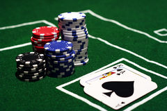 Blackjack with Stacks of Poker Chips. Stacks of poker chips on a green felt table with king and ace cards Royalty Free Stock Photo