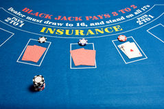 Blackjack Table. A regular blackjack table with cards and chips royalty free stock photography