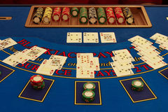 Blackjack table in casino with cards. And chips royalty free stock images