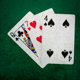 Blackjack Twenty One 7 - Square. Closeup view of playing cards forming the blackjack combination of twenty one points. This is the tree card combination of a Stock Photo
