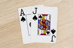 Blackjack casino playing poker cards. Blackjack - winning hand of gambling casino poker playing cards on a table royalty free stock photography