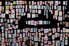 Blackmail. Set of magazine letters cutout on black background with the word blackmail in the middle Stock Photography