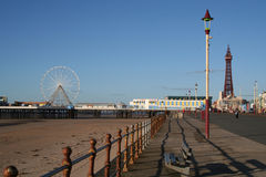 Blackpool Central Pier, Ferris Wheel, Promenade and Tower. View of the central pier at Blackpool with the tower in the distance royalty free stock images