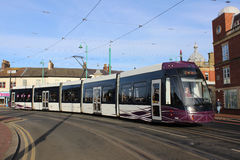 Blackpool tram on Lord street in Fleetwood. One of the new Blackpool trams rounds a curve onto Lord Street in Fleetwood, Lancashire with a service from Fleetwood Stock Photos