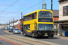 Blackpool transport double deck bus in Fleetwood. Double deck bus operated by Blackpool transport and in their yellow and black livery on North Albert street Royalty Free Stock Image