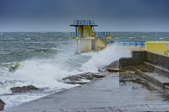 Blackrock diving board at Salthill, Co. Galway during a storm.  stock photo