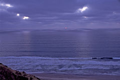 Blacks Beach at Twilight. Frothy waves roll in on Blacks Beach, CA as twilight falls over the ocean and shore Royalty Free Stock Image