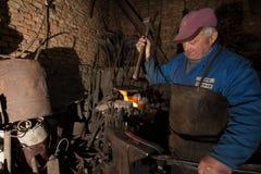 Blacksmith в действии Стоковые Изображения RF