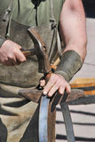 Blacksmith. Detail of the hands of a blacksmith. Metalworker and artisan Royalty Free Stock Images