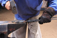 Blacksmith. Black smith make with forge hammer an arrow Stock Images