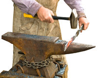 Blacksmith. Working on a metal detail, hand with hammer blurred in motion, isolated Stock Photo