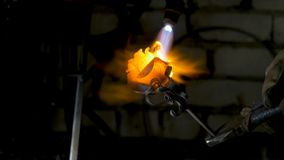 Blacksmith aligns leaves of iron rose and makes the final shape of the flower. Blacksmith makes iron rose Stock Photos