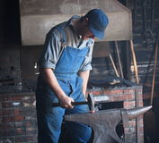 Blacksmith With Anvil Stock Images