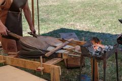 Blacksmith Blows Coals with Bellows, Working Tool Stock Images