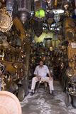 The blacksmith in cairo. The owner of an ironware store sat in his place waiting for buyer. In this  Khan el-Khalili Bazaar in cairo, the potential customer for Royalty Free Stock Images