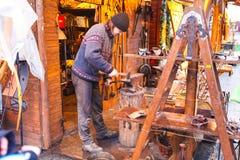 Blacksmith on a Christmas market Stock Photos
