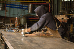 Blacksmith cleaning table Royalty Free Stock Photography