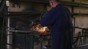 Blacksmith cuts steel on a machine stock video