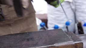 Blacksmith demonstrate their skills and forges corkscrew at Christmas fair stock video