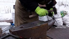 Blacksmith demonstrate their skills and forges corkscrew at Christmas fair stock footage