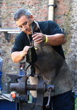 Blacksmith finishing iron flower Royalty Free Stock Photo
