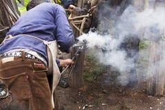 Blacksmith fitting horseshoe royalty free stock images