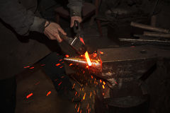 Blacksmith forfing hot iron Royalty Free Stock Photography