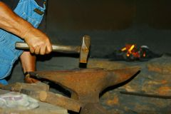 Blacksmith at forge stock image