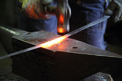 Blacksmith in a forge Stock Photography