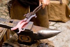 Blacksmith forged iron smith anvil hammerman royalty free stock images