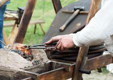 Blacksmith forges detail. Blacksmith forges a detail on an open fire royalty free stock photo