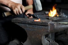 Blacksmith forges iron Royalty Free Stock Images
